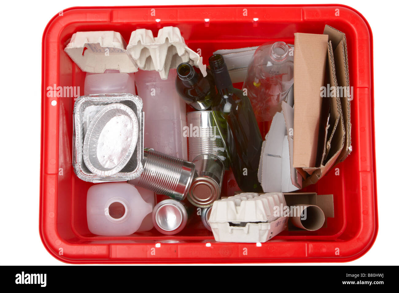 various items of household waste placed in a kerbie kerbside collection bin for recycling including aluminium food - Stock Image