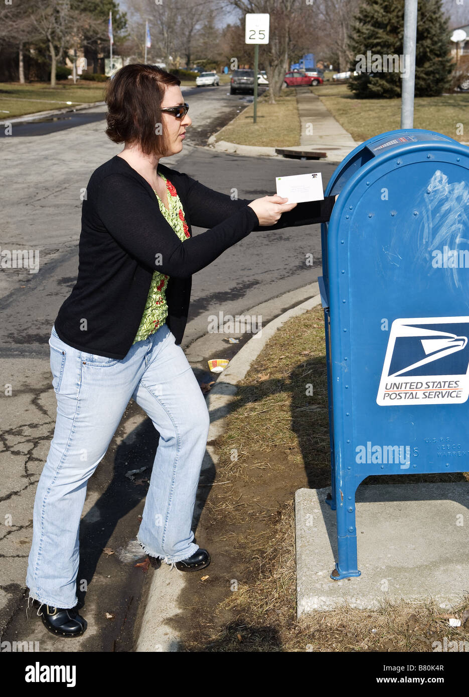 A woman mailing a letter - Stock Image