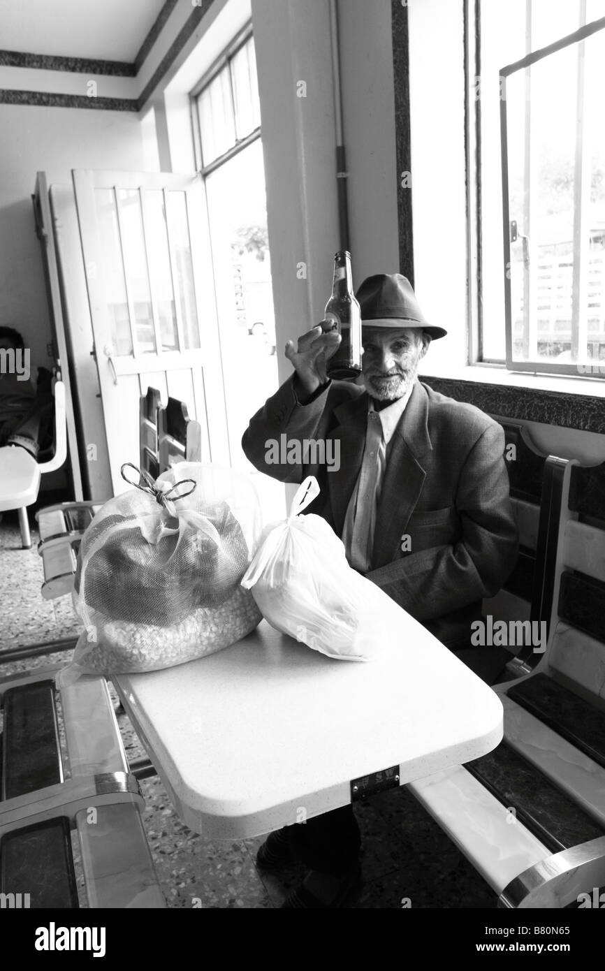 Portrait of an old man having a beer.Sutamarchan, Boyacá, Colombia, South America, Andes - Stock Image