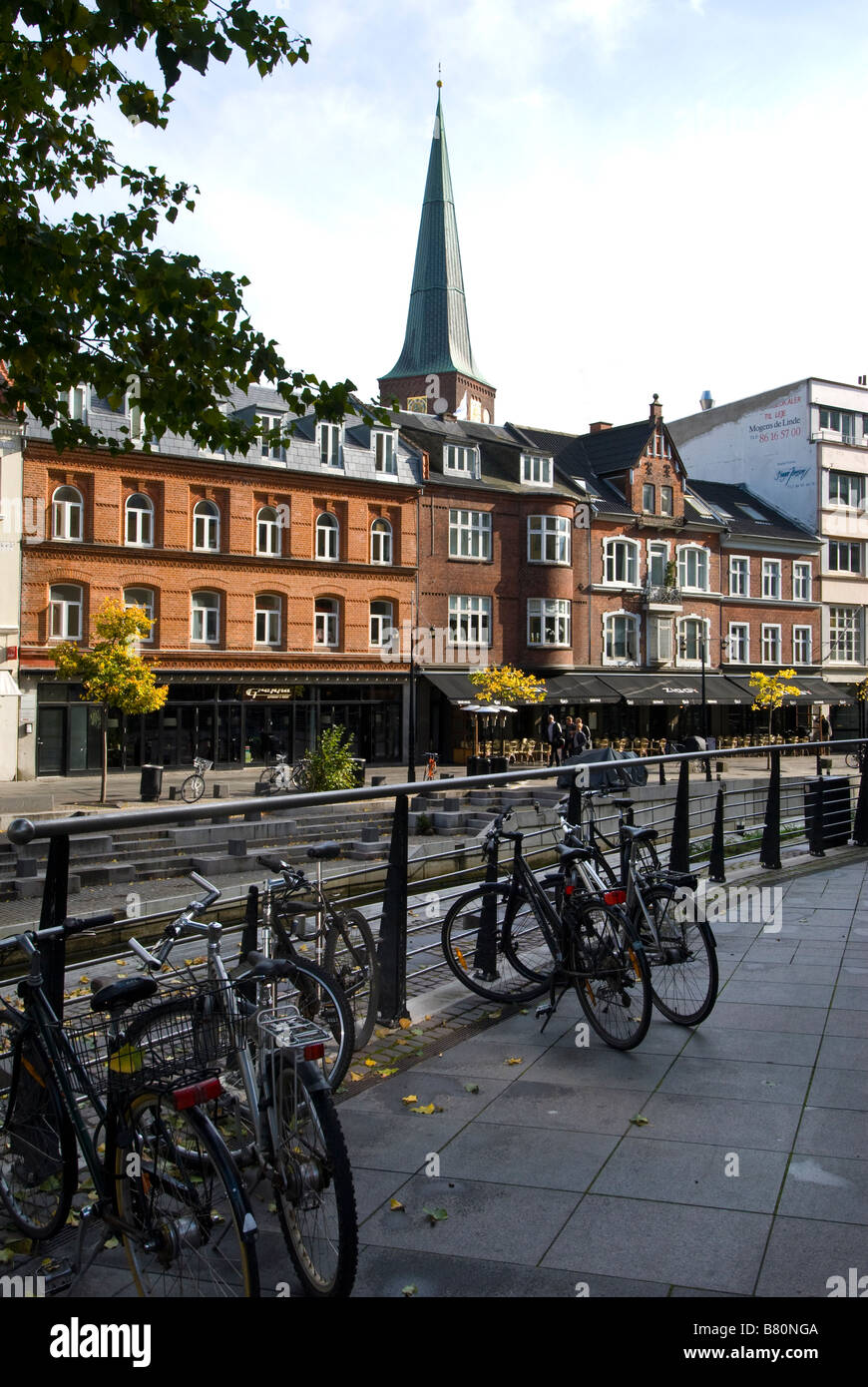 Bicycles parked by railings on Aboulevarden, Arhus, Denmark - Stock Image