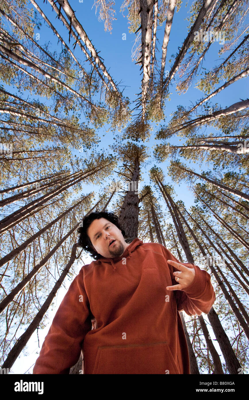 A man flashes a sign under trees MR YES October 8 2008 - Stock Image