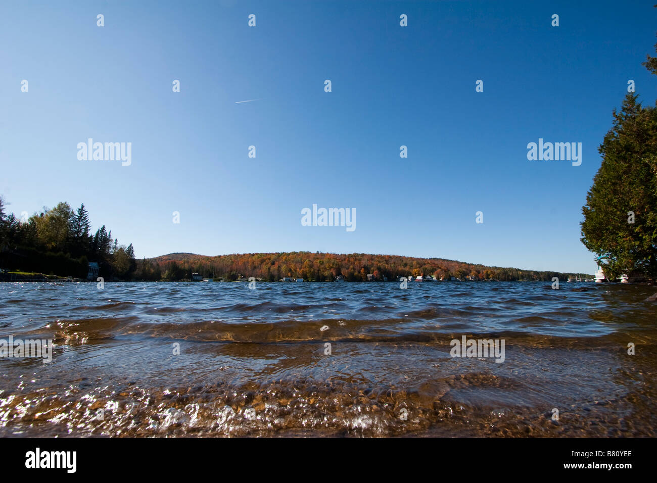 Water ripples lapping up on a shore RF October 7 2008 - Stock Image