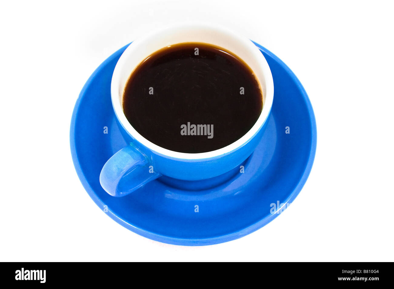 Cup of black coffee in a bright blue cup and saucer on a white background - Stock Image