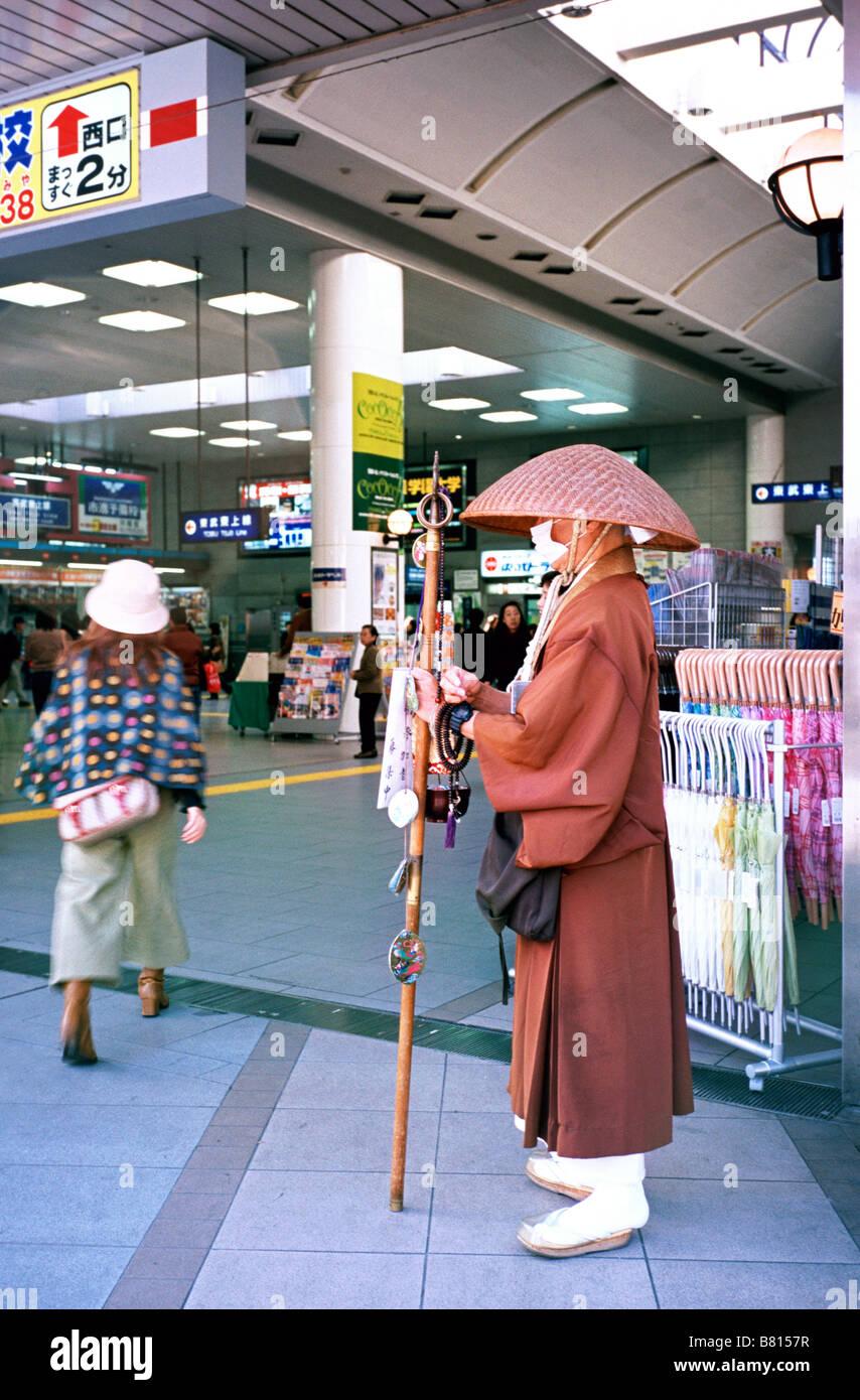 Nov 3, 2004 - Buddhist monk asking for alms outside the station of Kawagoe (Little Edo) in Japan. - Stock Image