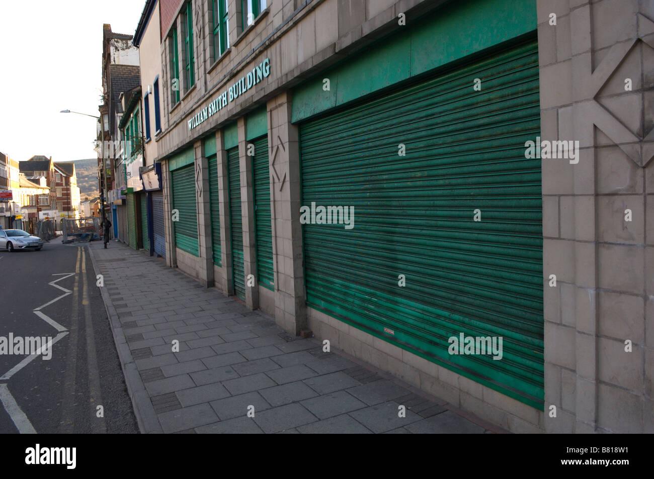 Locked up shop fronts Merthyr Tydfil Wales United Kingdom Europe - Stock Image