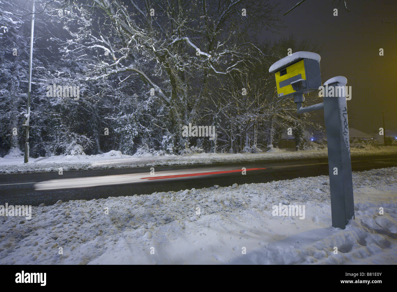 Gatso speed camera in snow on wintery A road Surrey England UK - Stock Image