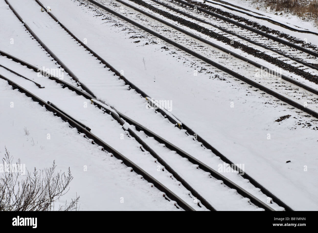 Railway lines in snow, UK - Stock Image