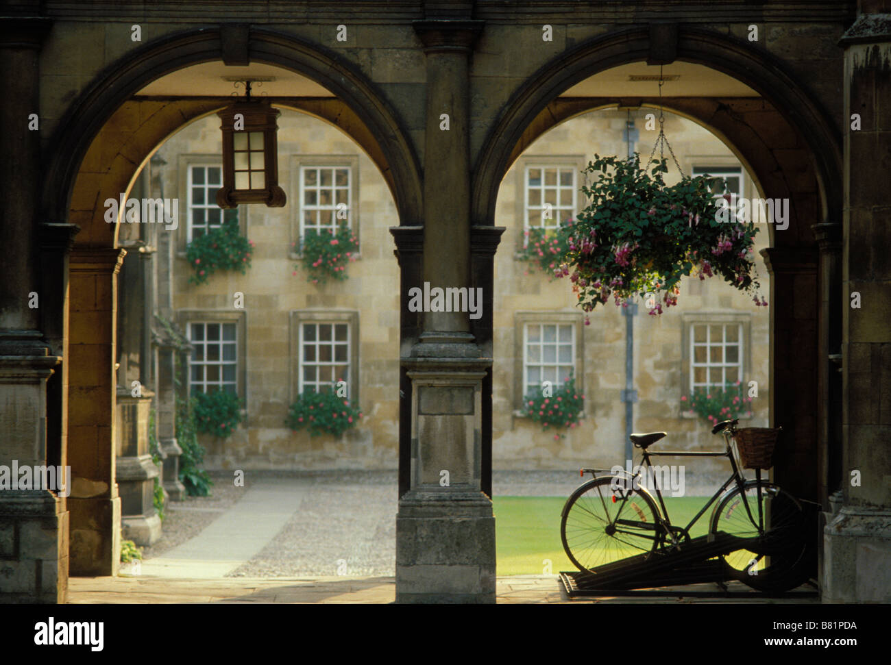 A parked bicycle under the cloister archway to the quadrangle of Peterhouse College, Cambridge University UK - Stock Image