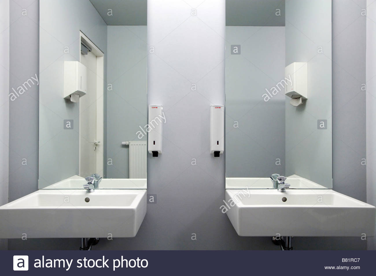 public bathroom sink with faucet paper towel and soap dispenser ...