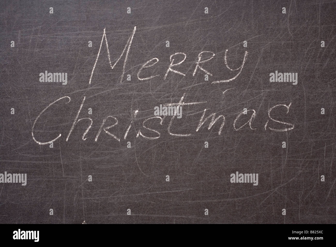 Merry christmas written on the school desk - Stock Image