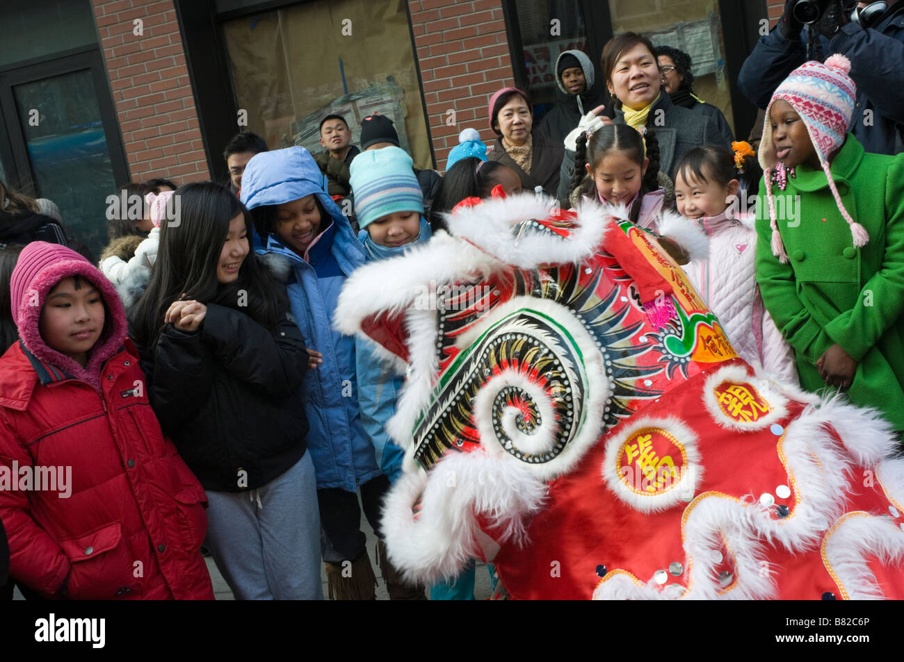 New York NY 26 January 2009 Children are  greeted by a Lion Dancer as the Chinatown community marks the Year of - Stock Image