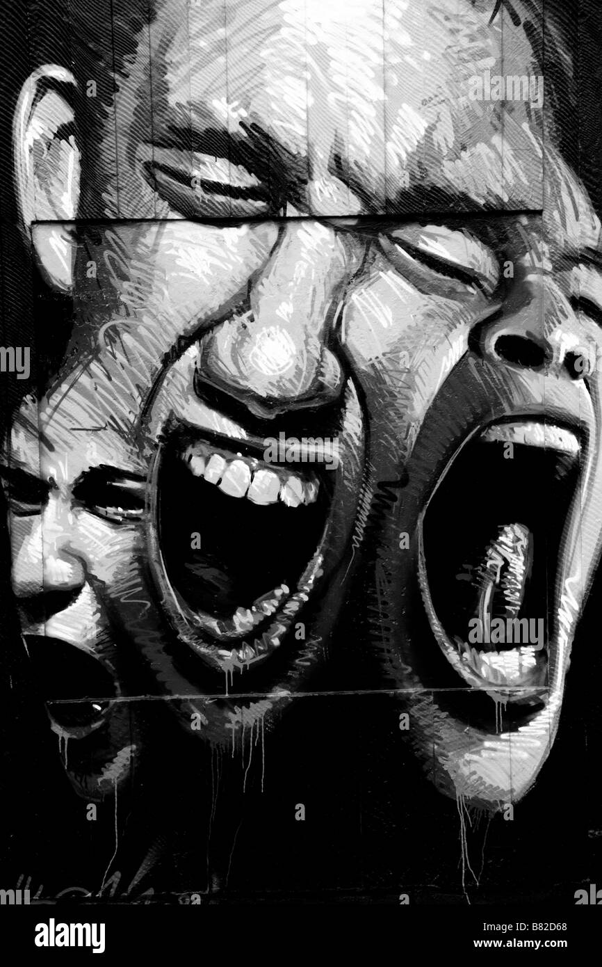 Graffiti screaming faces black and white - Stock Image