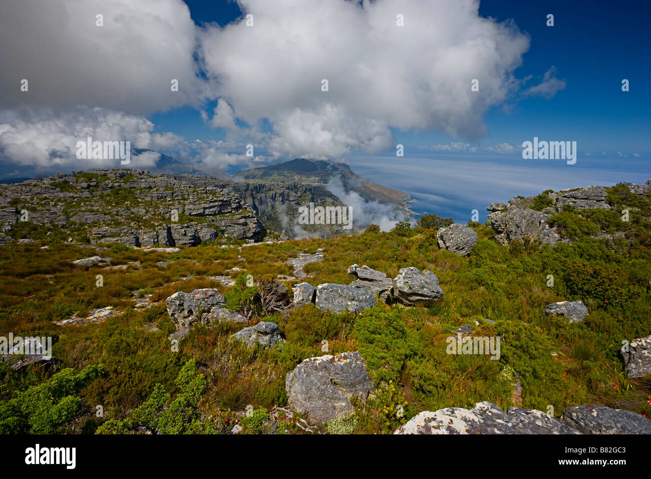 scenic view looking down from the top of table mountain onto the sea towards Cape Town, South Africa - Stock Image
