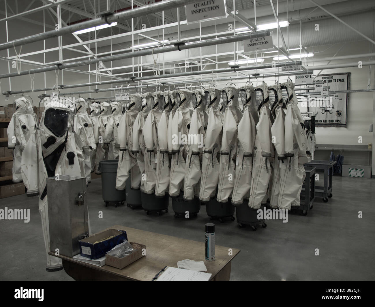 SUIT INSPECTING OTHER SUITS SCAPE SUIT FACILITY AT KENNEDY