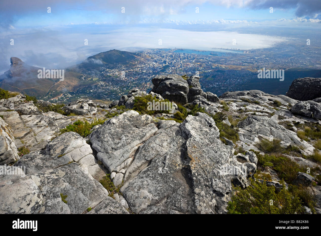 scenic view looking down from the top of table mountain onto Cape Town, South Africa - Stock Image