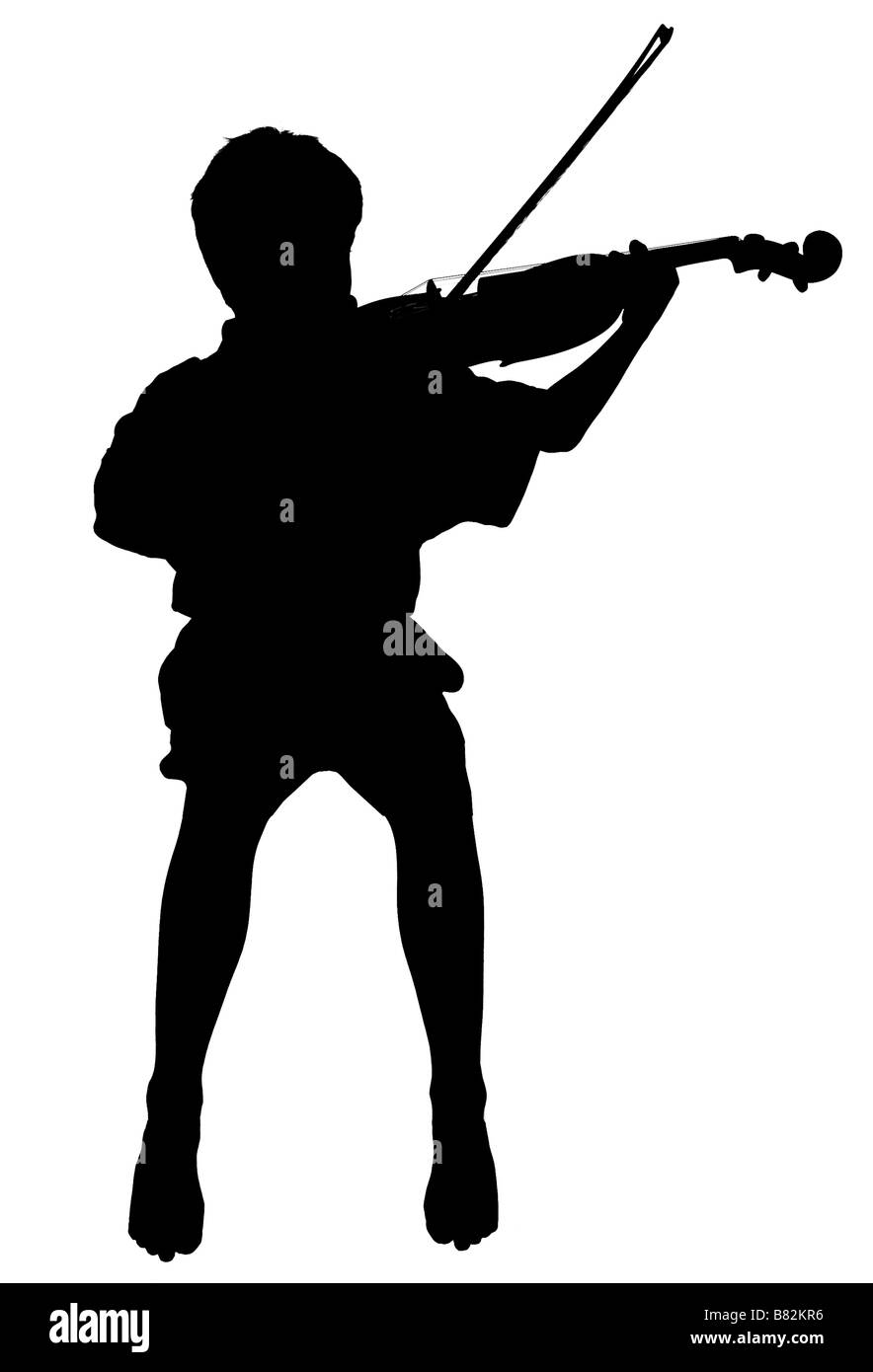 silhouette of boy playing the violin - Stock Image