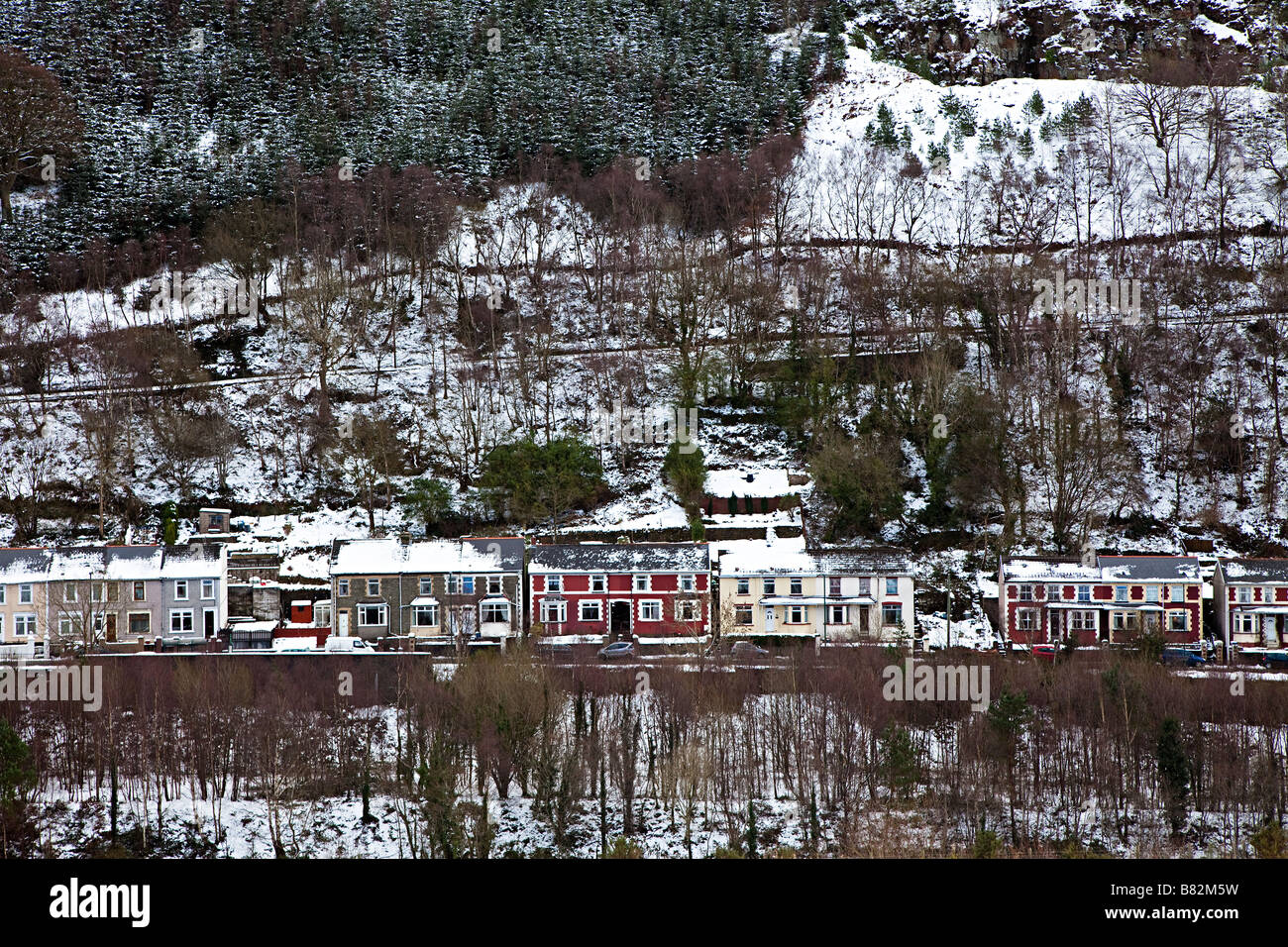 Street of houses at Six Bells in the South Wales valleys in winter Wales UK - Stock Image