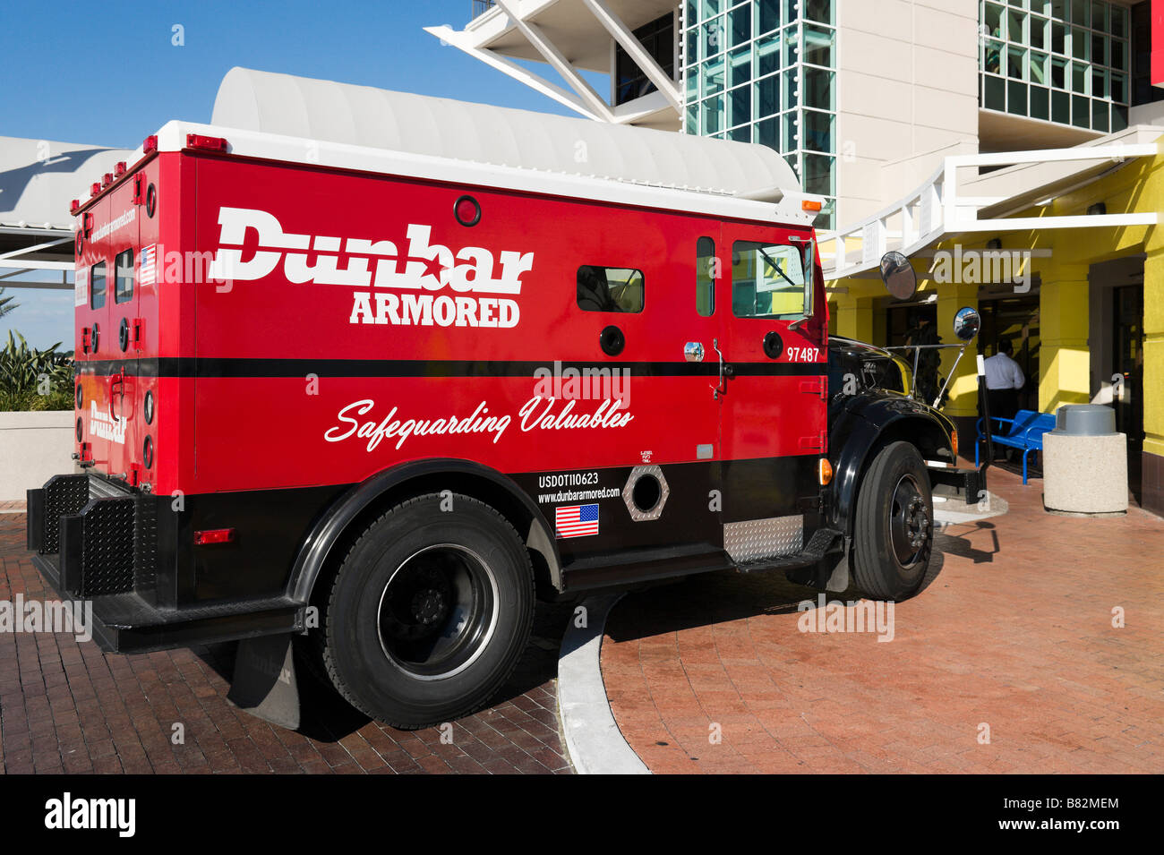 Dunbar Armored Truck outside the entrance to St Petersburg Pier, St Petersburg, Gulf Coast, Florida, USA - Stock Image