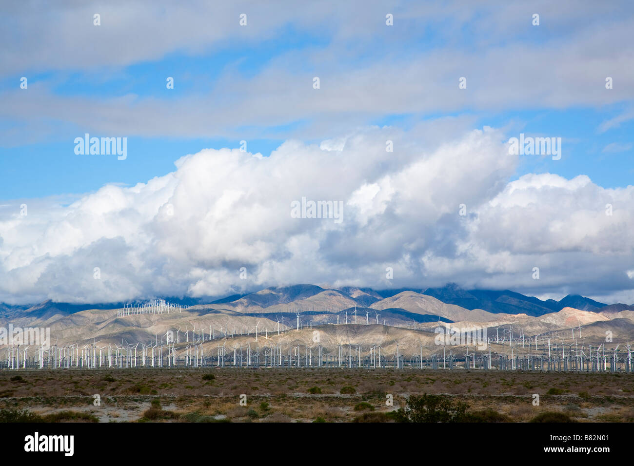 Dramatic sky with large fields of wind turbines outside of Palm Springs California - Stock Image