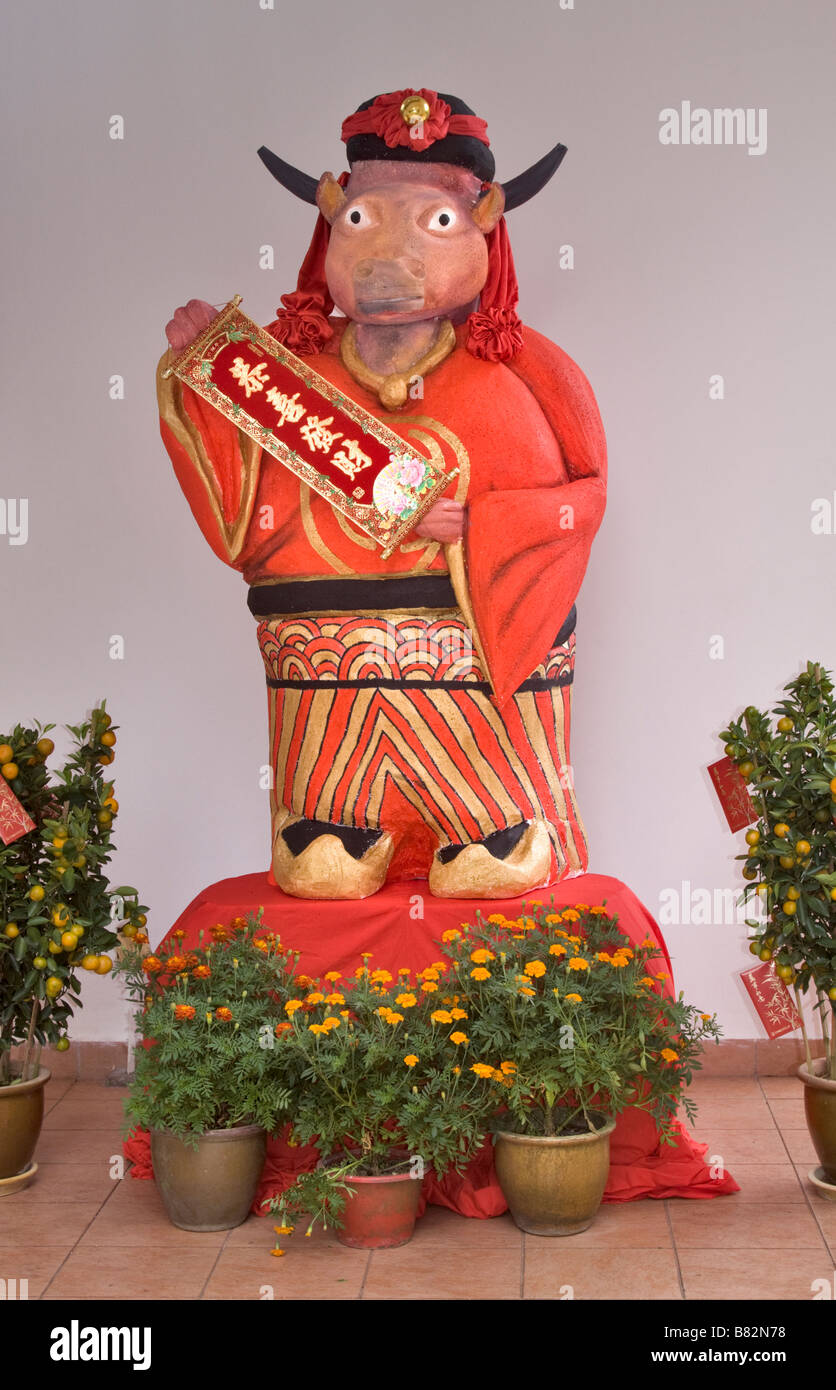 Brightly painted statue of an ox celebrating Chinese New Year - Stock Image