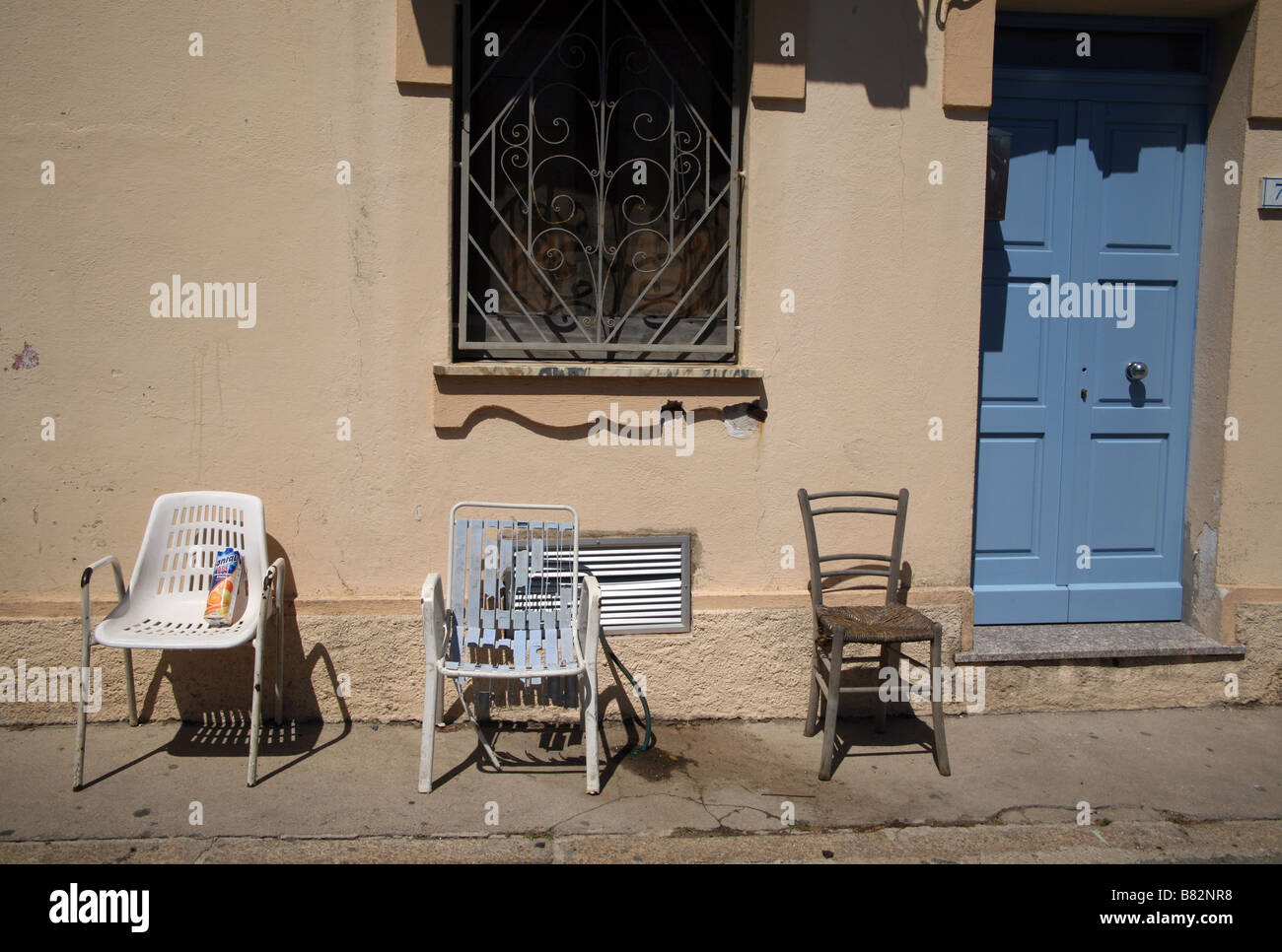 Three Chairs Outside A House In Sardinia   Stock Image