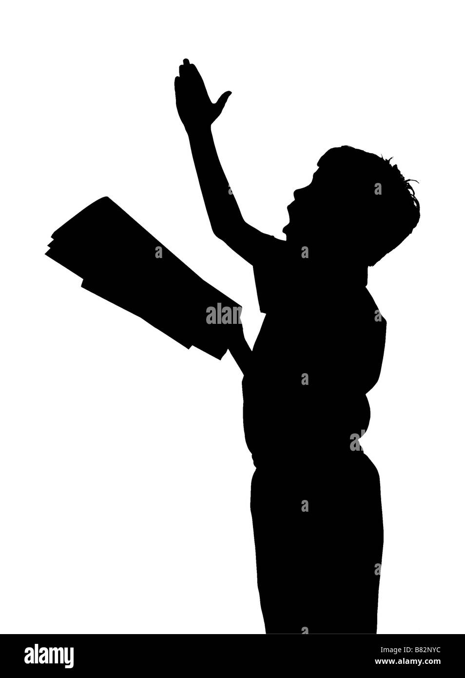 silhouette of boy giving a performance - Stock Image
