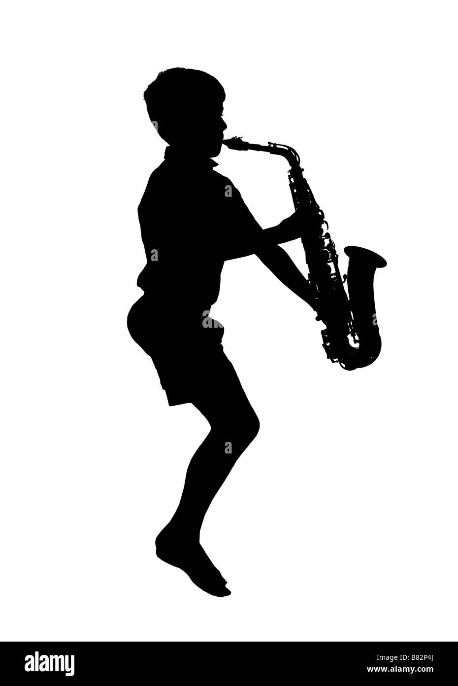 silhouette of boy playing saxophone - Stock Image