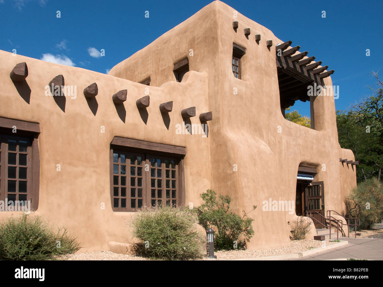 Typical adobe architecture exterior Fine Arts Museum Santa Fe New Mexico USA - Stock Image