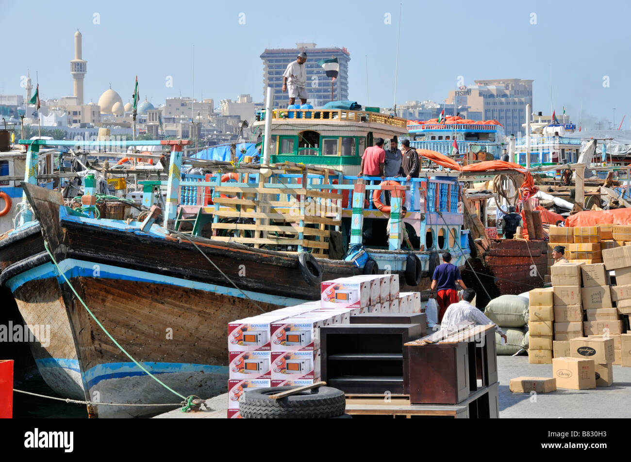 Dubai Creek and dhows with goods and merchandise stacked on the