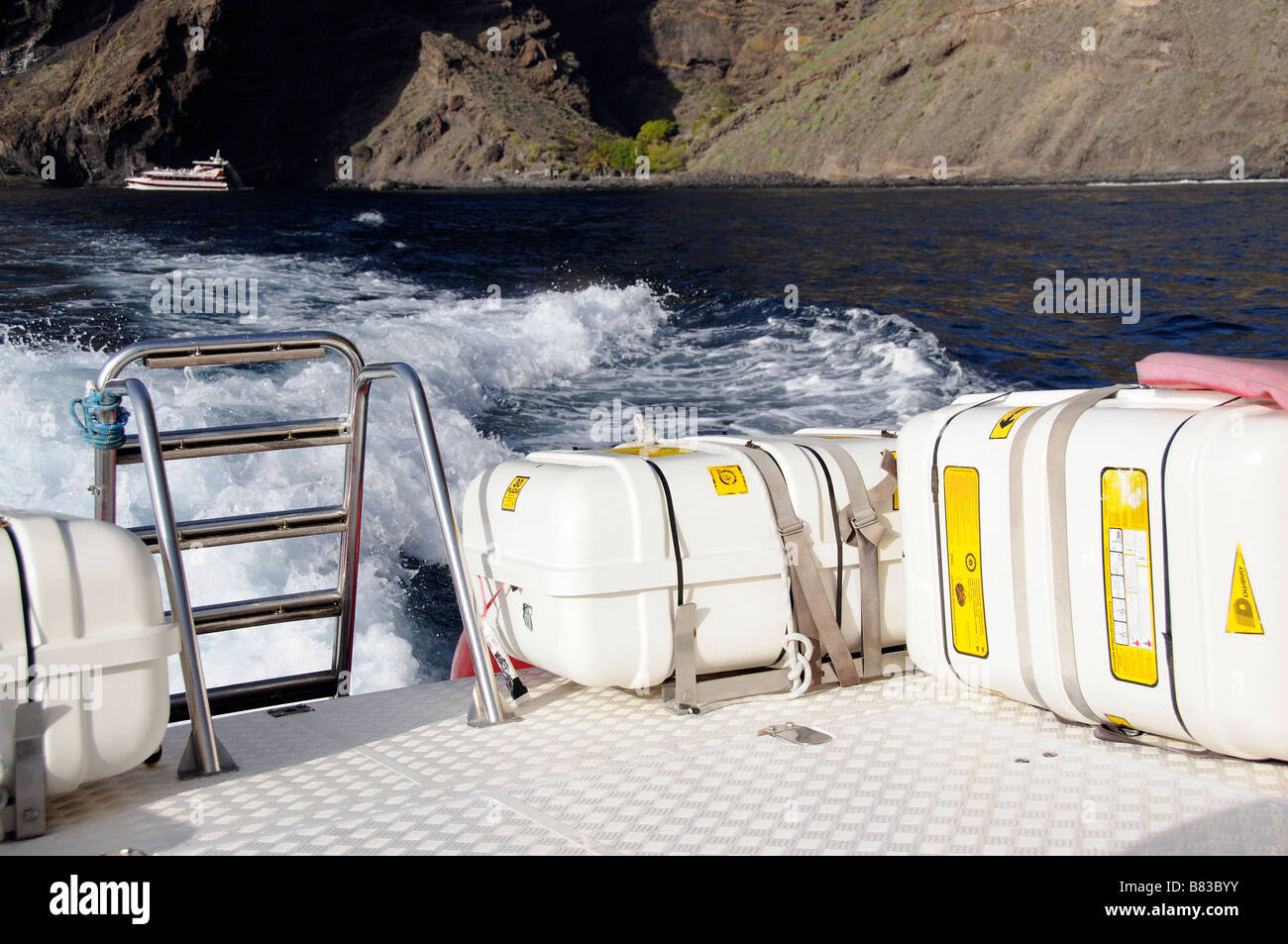 Marine safety equipment stowed on the deck of a fast tourist boat - Stock Image