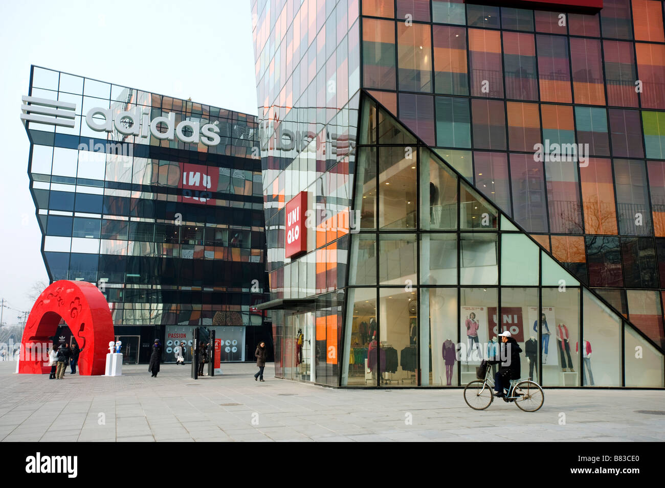 New ultra modern Uniqlo and Adidas flagship stores in new retail development called The Village in Beijing - Stock Image