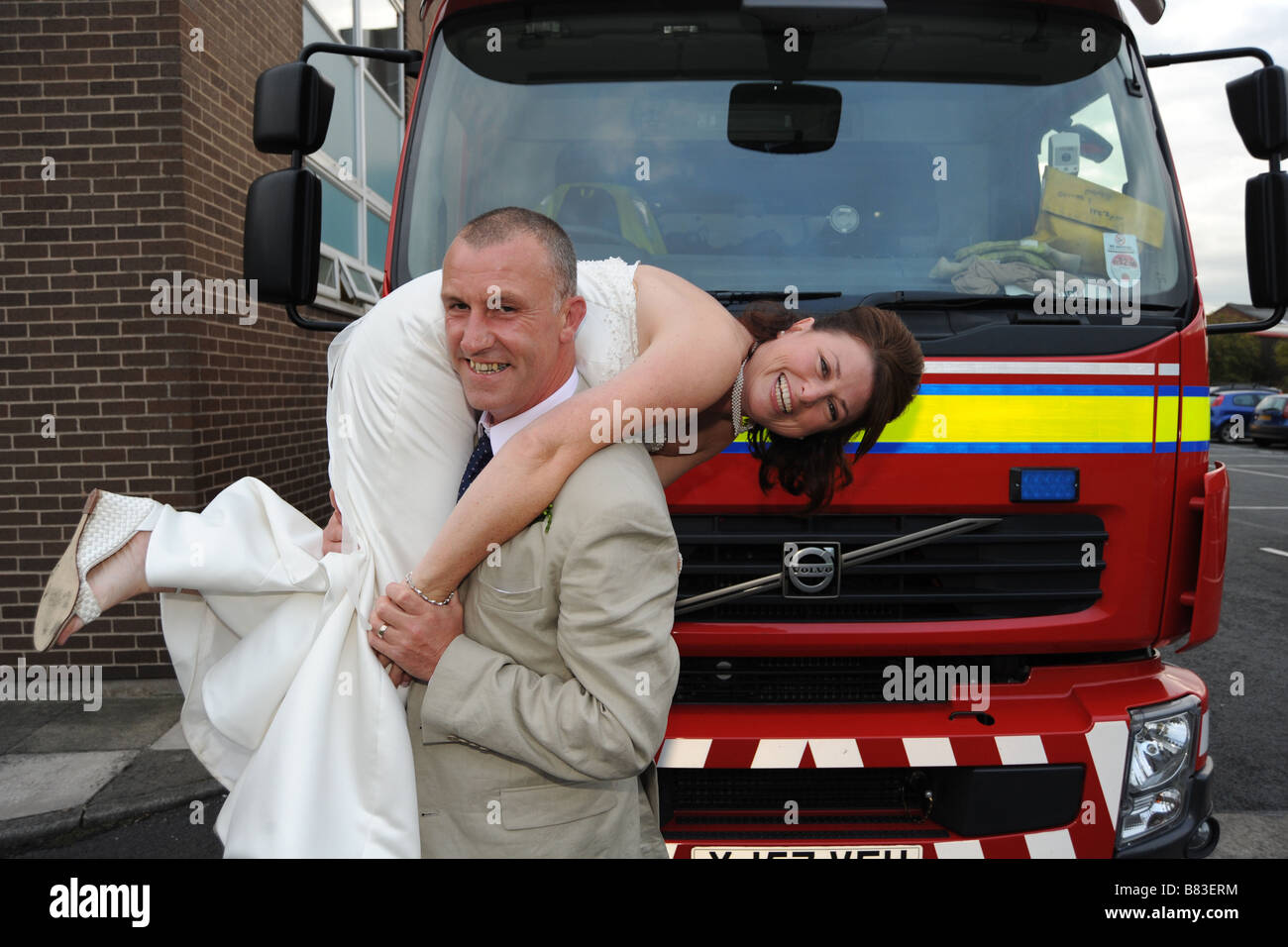 A fireman with his newly wed bride West Yorkshire Model Released - Stock Image