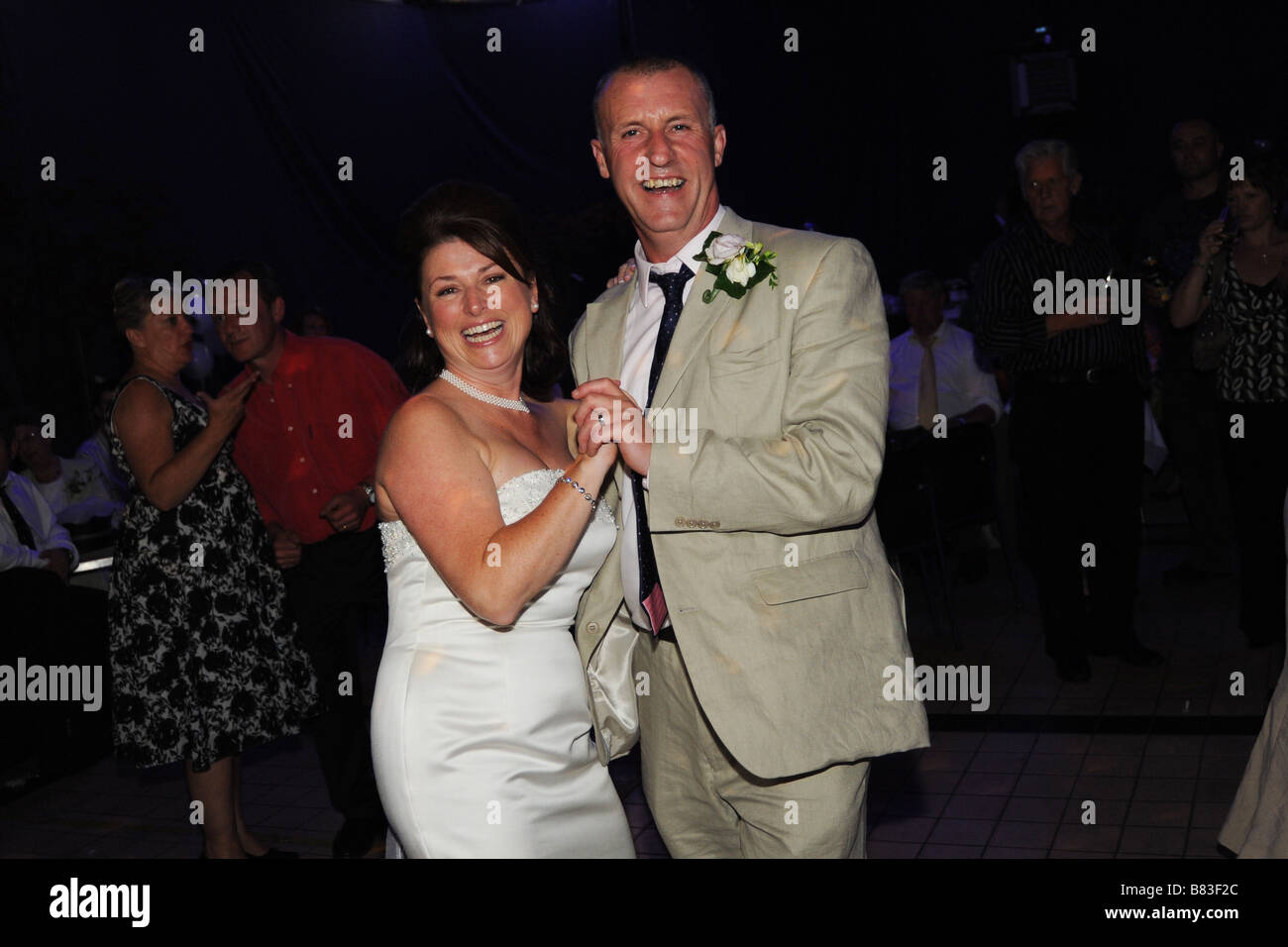 A Newly wed couple dance at their reception party, West Yorkshire Model Released - Stock Image