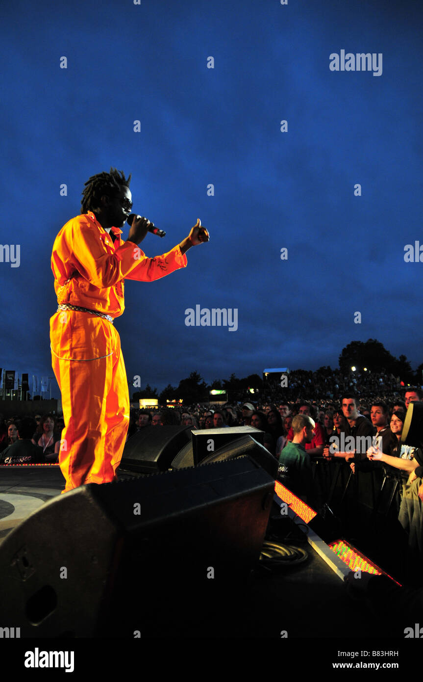 Emmanuel Jal performs to the crowd at a concert in London Stock Photo