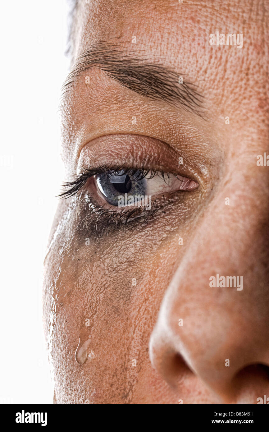 Close Up Shot of a Woman Crying - Stock Image