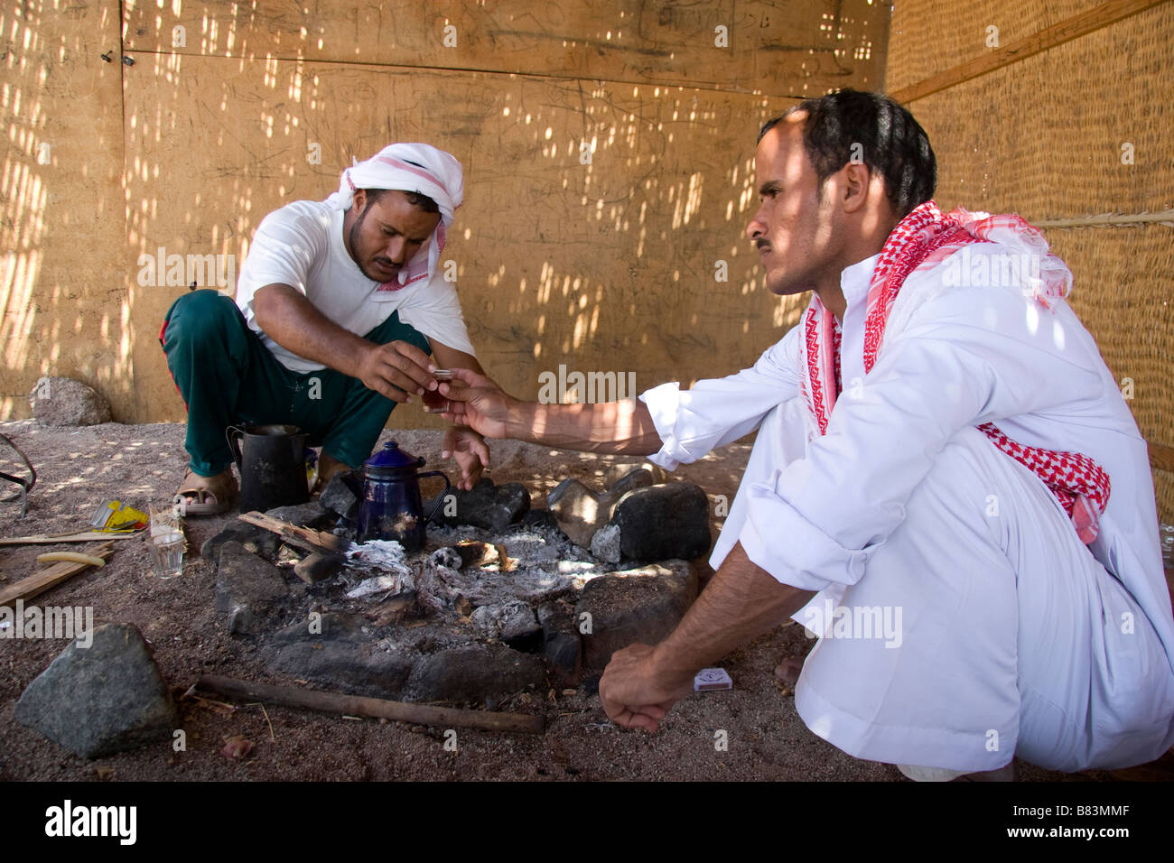 Bedouin host welcomes guests with customary tea in the village of Ras Abu Gallum, north of the Sinai resort of Dahab - Stock Image