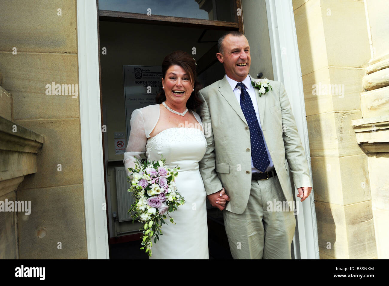Newly wed couple walk out of the registry office, North Yorkshire Model Released - Stock Image