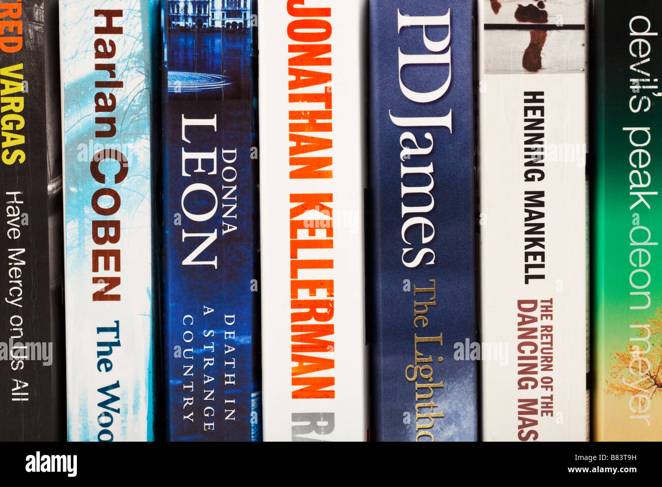 Row of spines of crime fiction novels close up - Stock Image