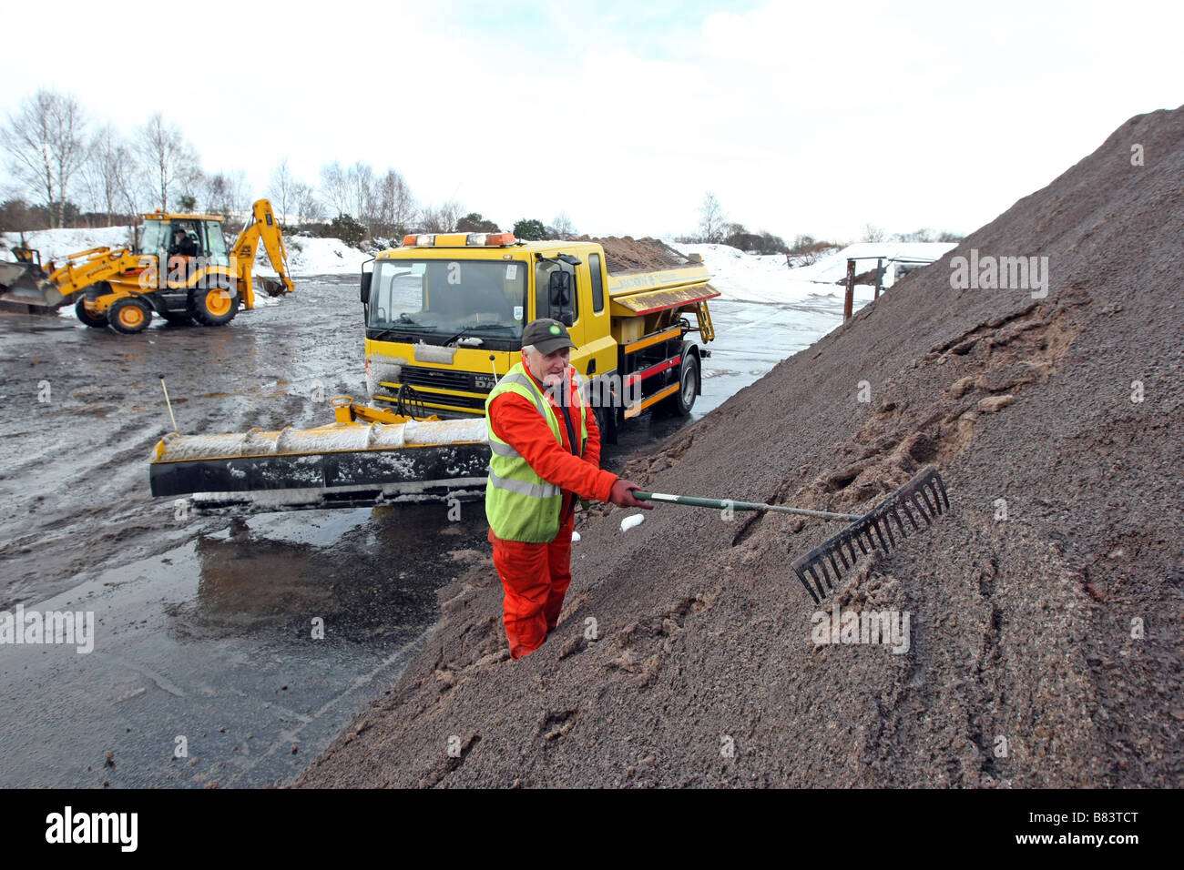 Gritters and snow ploughs being loaded with road grit at council roads depot in Aberdeenshire, scotland, UK - Stock Image