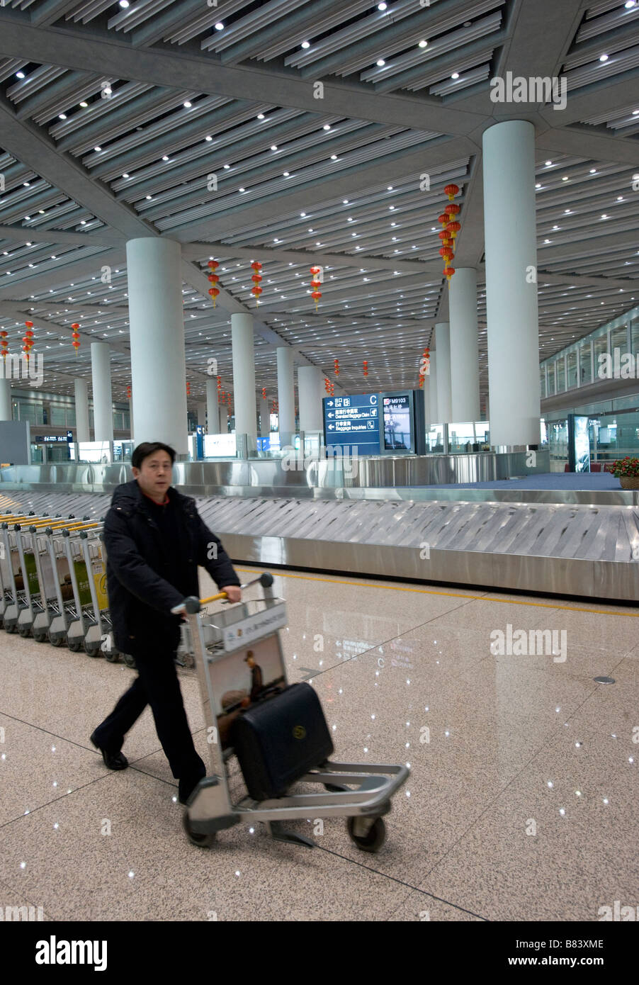 Interior of large modern baggage reclaim hall in new Beijing Airport Terminal 3 China 2009 - Stock Image