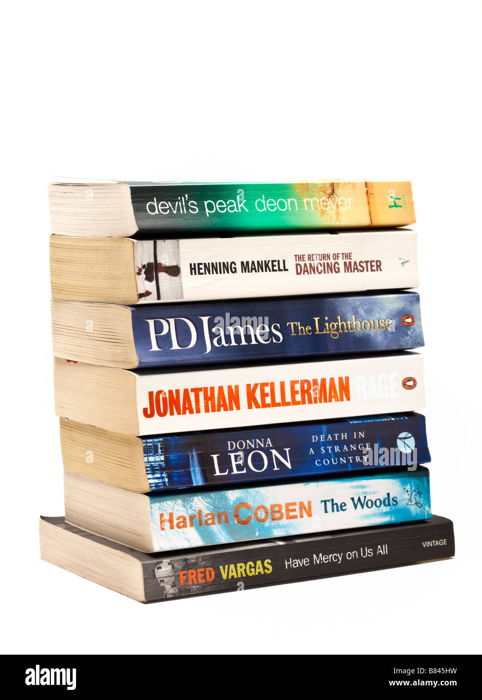 Cut out on white background pile of books - crime fiction novels on white - Stock Image