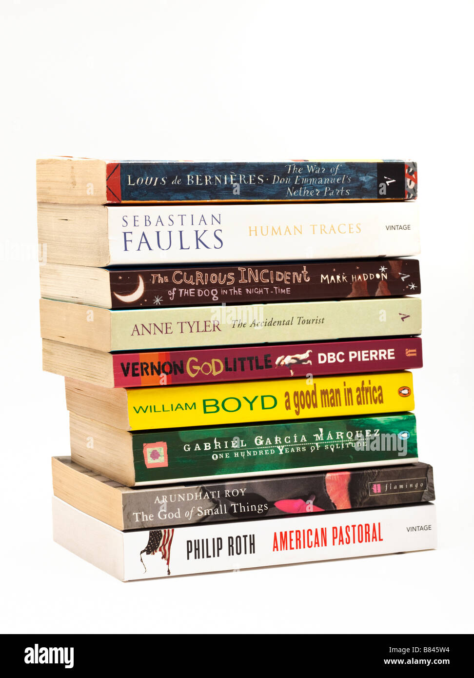Studio shot of stack of book, literary fiction novels on white background cut out isolated - Stock Image