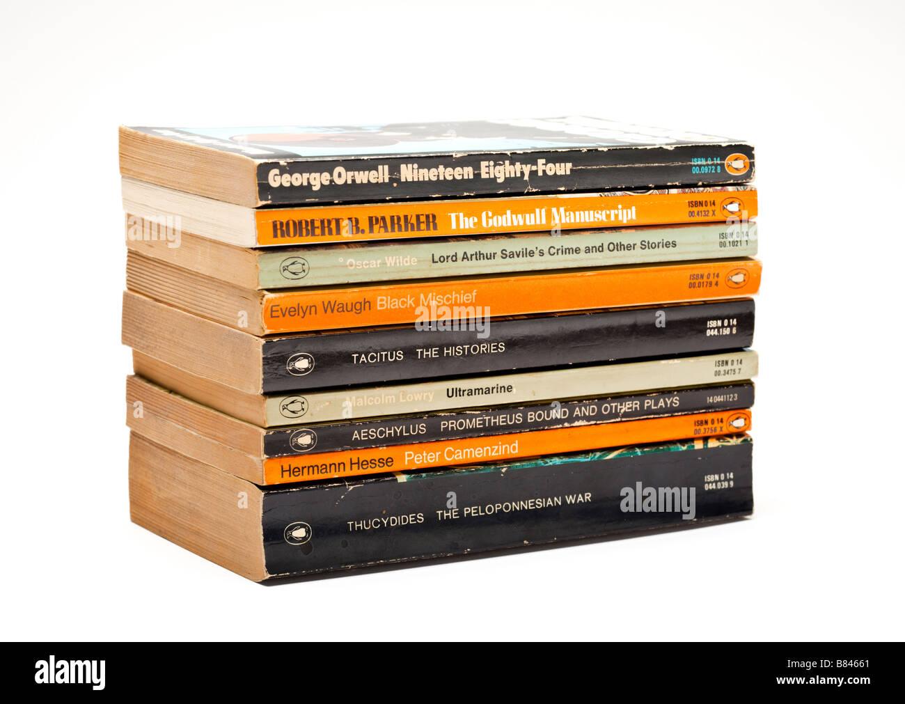 Stack of old Penguin classic novels books on white - Stock Image