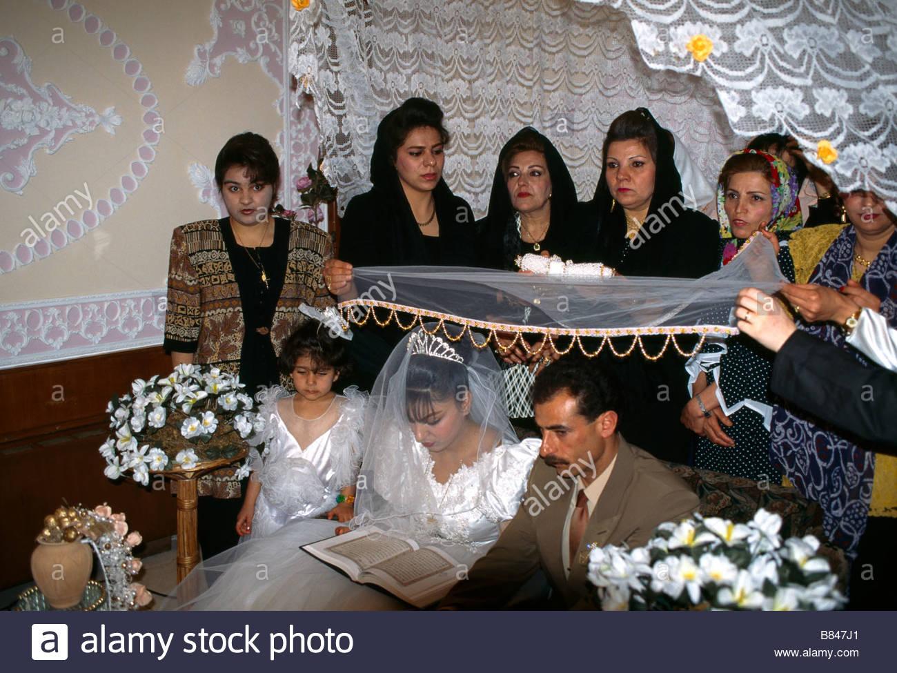 Shiraz Iran Islamic Wedding Ceremony Bride And Groom Exchange Vows Over Koran - Stock Image