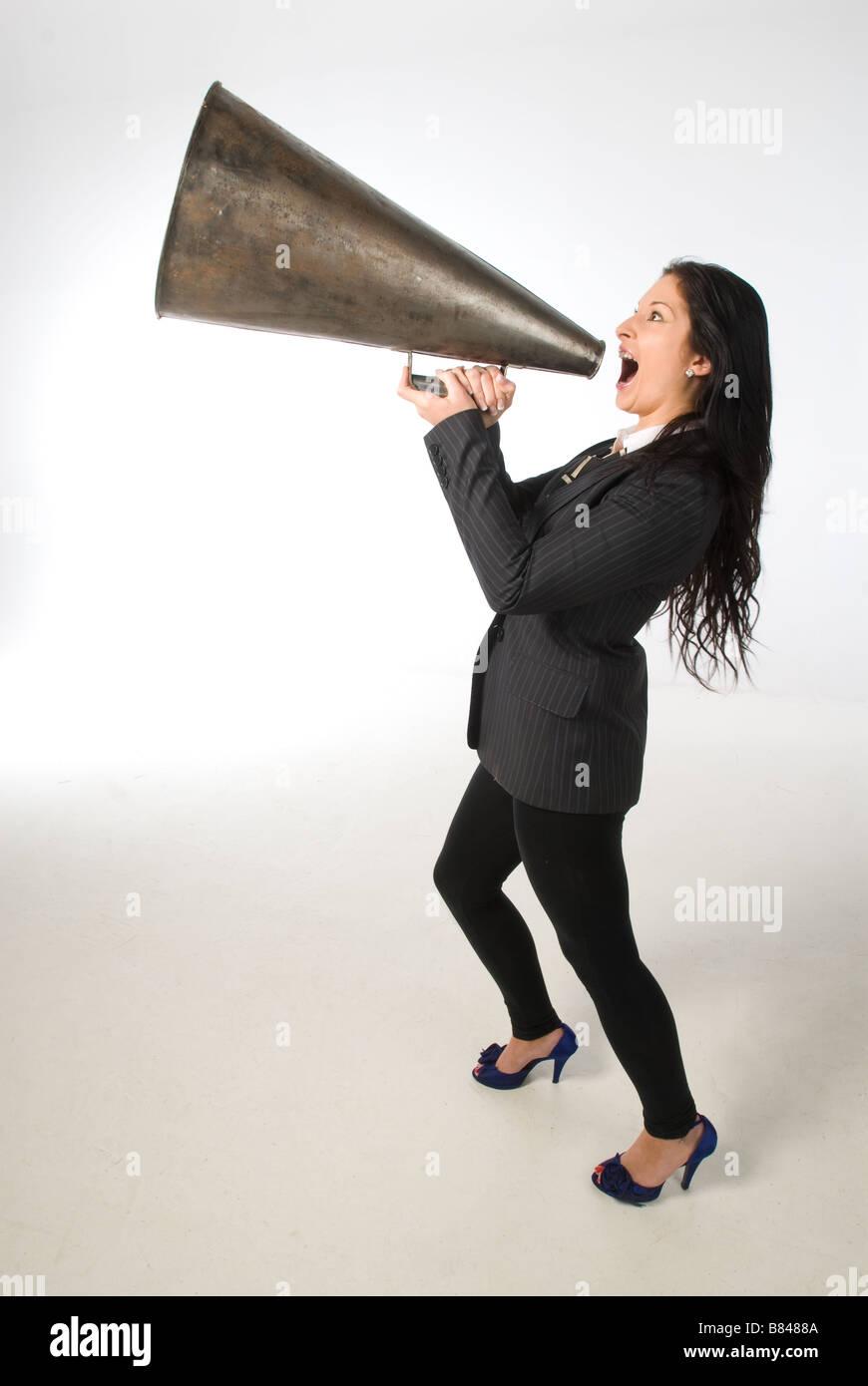 businesswoman shouting down loud hailer - Stock Image