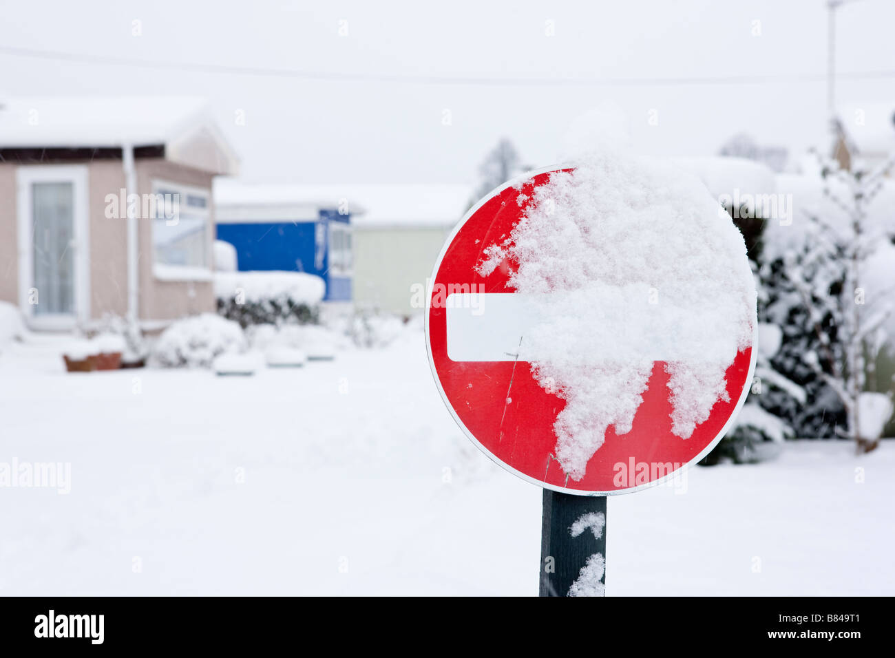 A no entry sign covered in snow - Stock Image
