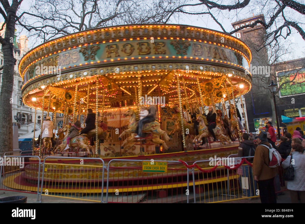 Carousel at Christmas Fair in Leicester Square, London England Great Britain GB UK - Stock Image
