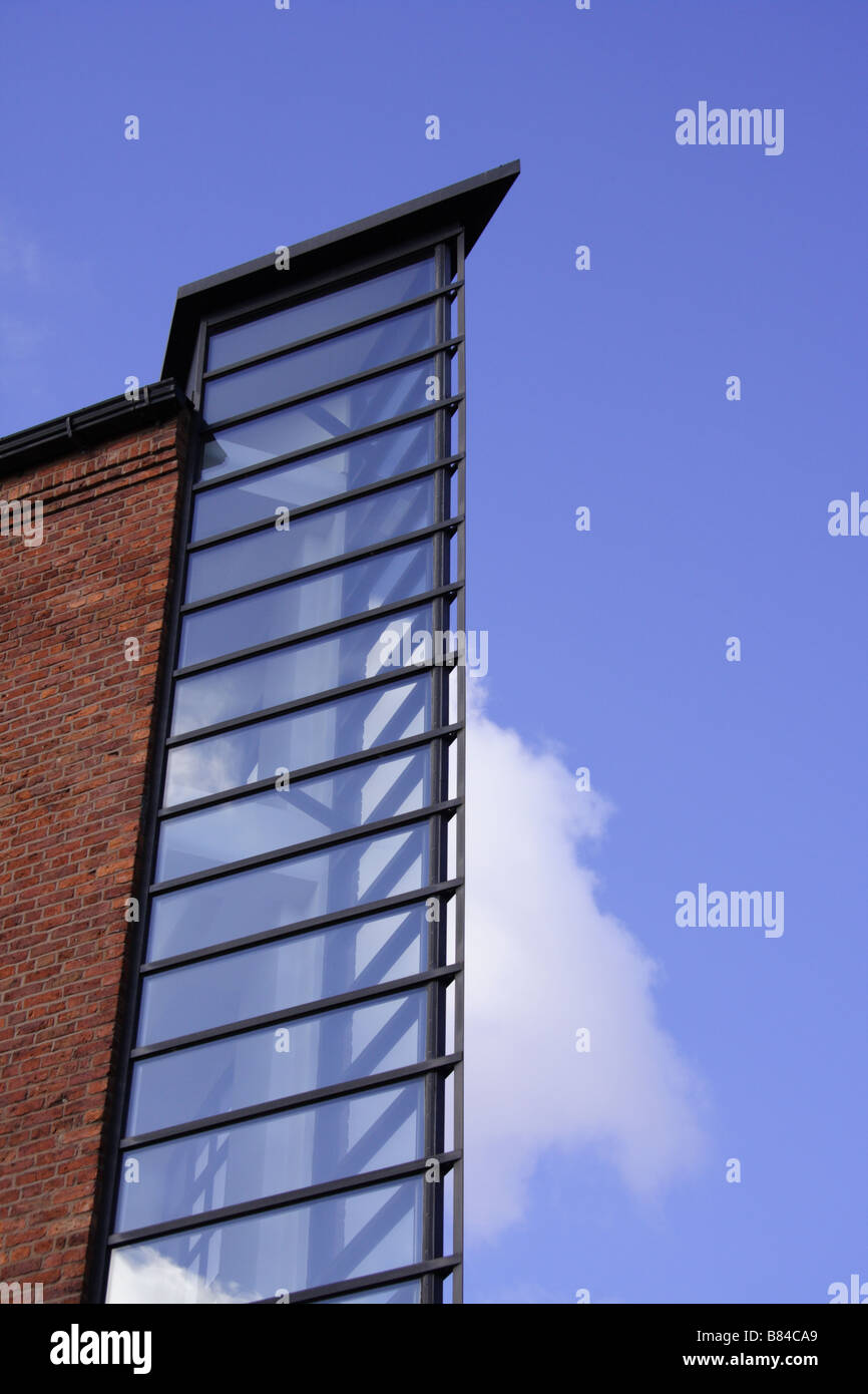 Architectural feature of an old mill building that has been converted into flats - Stock Image