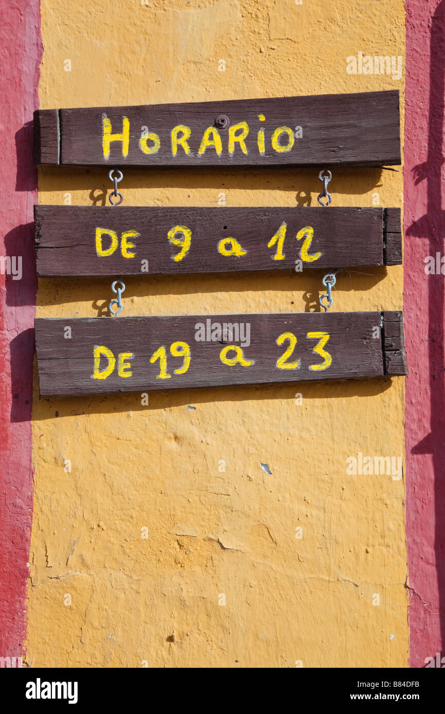 Horario or Opening Hours notice in the Spanish language outside a Spanish business - Stock Image