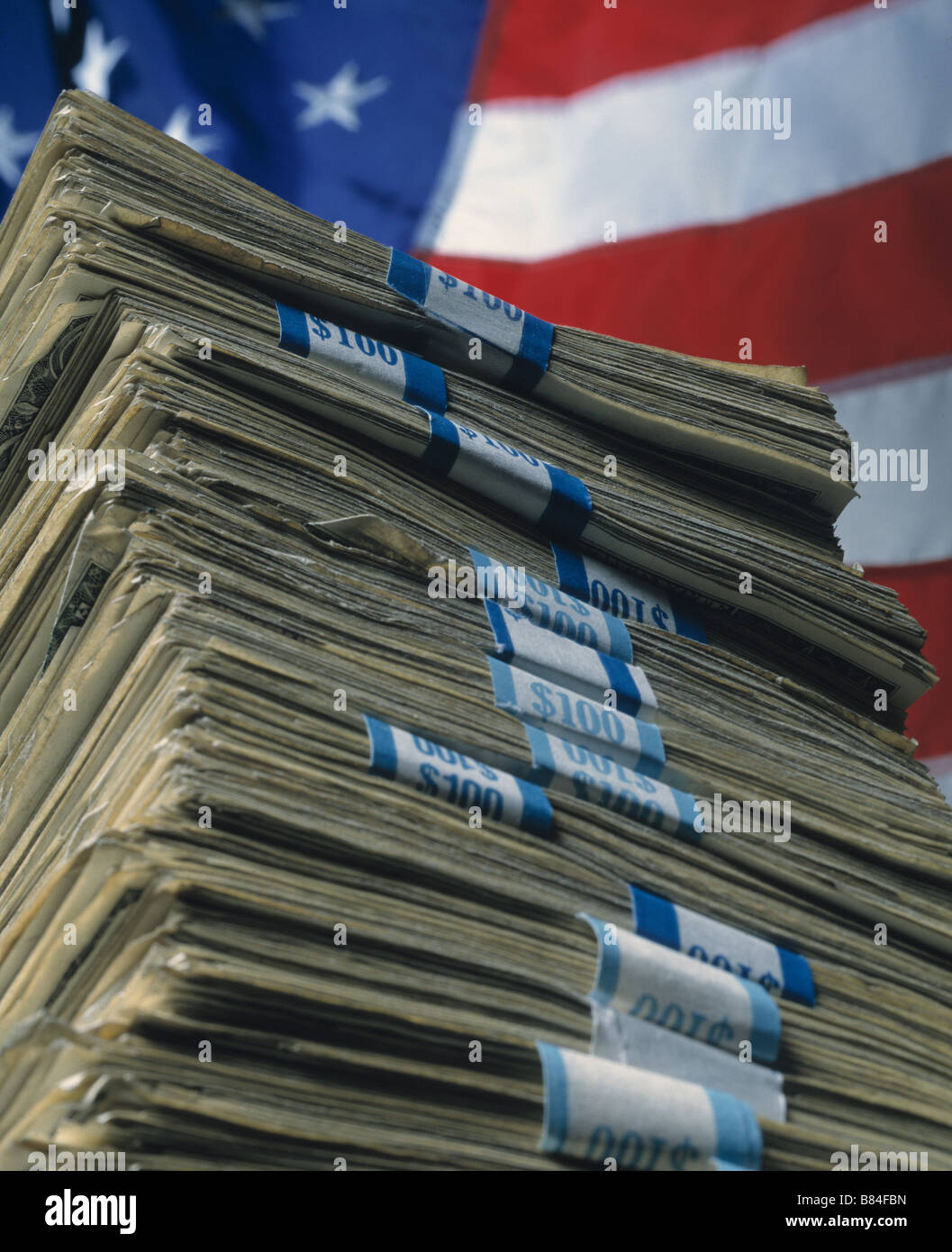 a huge stack of US currency as a symbol of the vast amount of money the USA Owes - Stock Image